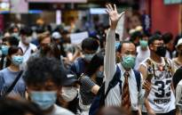 Protesters march on a road during a pro-democracy rally against a proposed new security law in Hong Kong on 24 May 2020. Picture: AFP