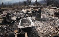 The shells of burnt out cars and appliances are all that's left of the homes of South African National Parks workers.Picture: Bertram Malgas