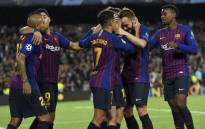Barcelona's Spanish defender Jordi Alba celebrates with teammates after scoring during the Uefa Champions League group B match Barcelona against Inter Milan at the Camp Nou stadium in Barcelona on 24 October, 2018. Picture: AFP.