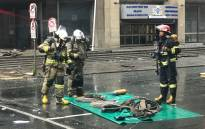 FILE: Firefighters begin clearing away equipment on 7 September 2018 near the Lisbon Building following the deadly fire there earlier this week. Picture: Christa Eybers/EWN.