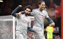 Liverpool's Mo Salah and Virgil van Dijk celebrate a goal. Picture: @LFC/Twitter