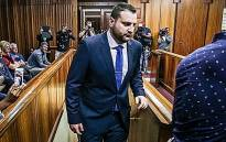 Christopher Panayiotou sits in the dock at Port Elizabeth High Court during the trial of the murder of his late wife, Jayde Panayiotou. Picture: Anthony Molyneaux/EWN
