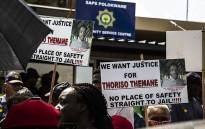 FILE: Residents outside Polokwane Police Station with banners marked 'Justice for Thoriso'. Picture: Kayleen Morgan/EWN.