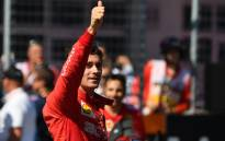 Ferrari's Monegasque driver Charles Leclerc celebrates after the qualifying session of the Austrian Formula One Grand Prix in Spielberg on 29 June 2019. Ferrari's Charles Leclerc shut out Lewis Hamilton to take pole for the Austrian Grand Prix with a new lap record in final qualifying on Saturday. Picture: AFP