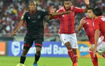 Orlando Pirates' Thabo Matlaba escapes with the ball during CAF Champions League first leg final between Orlando Pirates and Al-Ahly in Soweto on 2 November, 2013. Picture: AFP