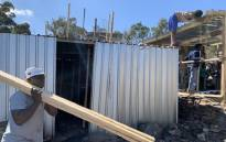 Imizamo Yethu residents rebuild their homes on 9 September 2020 after a devastating fire on 6 September 2020. Picture: Kaylynn Palm/EWN