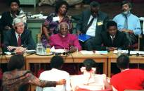 FILE: Then Archbishop Desmond Tutu (centre) with fellow commissioners listen to testimony from witnesses during the start of the Truth and Reconciliation Commission which opened in East London, 15 April 1996. Picture: AFP.
