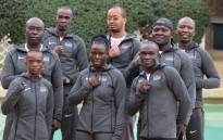 Christine Ongare (left) and her teammates on Kenya's national boxing team at the Tokyo Olympic Games. Picture: @KenyaBoxing/Twitter