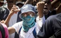 A University of Pretoria student demonstrates during protests on the institution's Hatfield campus over possible university fee hikes for the 2017 academic year. Picture: Reinart Toerien/EWN.