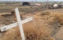 A cross erected on the Koppie after the massacre as a symbol of the lives lost in Marikana. Picture: EWN.