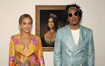 Beyoncé and Jay-Z stand in front of a portrait of the Duchess of Sussex, Meghan Markle. Picture: @beyonce/instagram.com