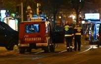 Firefighters and police cars stand near Schwedenplatz square following a shooting in the center of Vienna on 2 November 2020. Picture: AFP