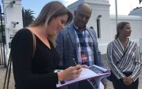 Advocacy group SA Women Fight Back hand over a petition to the Presidency in Cape Town on 6 March 2020 to pressure government to make good on its promises. Picture: Jarita Kassen/EWN