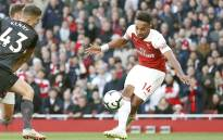 Arsenal's Gabonese striker Pierre-Emerick Aubameyang scores his team's second goal during the English Premier League football match between Arsenal and Everton at the Emirates Stadium in London on 23 September 2018. Picture: AFP.