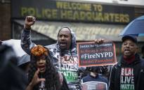 People protest outside the police headquarters while a disciplinary hearing takes place for officer Daniel Pantaleo on 13 May 2019 in New York City. Picture: AFP