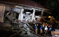 Rescue workers search for survivors in a collapsed Chuzon Super Market in Porac, Pampanga, after a powerful earthquake hit the northern Philippines on 22 April 2019. Picture: AFP.
