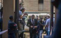 Oscar Pistorius arrives at the high court in Pretoria to set down a date for new sentencing procedures following the murder of his girlfriend Reeva Steenkamp. Picture: Reinart Toerien/EWN.
