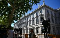 FILE: Journalists set cameras in front of Spain's Supreme Court in Madrid on 21 June 2019, on the day the court will examine a case so controversial it sparked mass protests after five men accused of gang-raping a woman were convicted of the lesser crime of sexual abuse. Picture: AFP