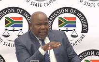 A screenshot shows Mxolisi Nxasana at the state capture inquiry on 2 September 2019.