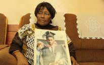 Charity Kondile with a photograph of her son Sizwe Kondile. Picture: Mandy Wiener.