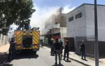 Angry community members in Parow on 21 February 2020 set fire to two homes, a two-story building and smashed a vehicle, following the murder of Tazne van Wyk. Picture: Lizell Persens/EWN