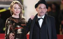 """Australian actress Kylie Minogue and French Actor Denis Lavant arrive for the screening of """"Holy Motors""""."""