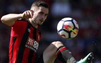 FILE: In this file photo taken on 5 May 2018 Bournemouth's English midfielder Lewis Cook controls the ball during the English Premier League football match between Bournemouth and Swansea City at the Vitality Stadium in Bournemouth, southern England on 5 May 2018. Picture: AFP