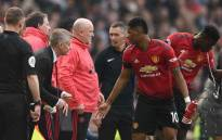 Manchester United's English striker Marcus Rashford (R) talks with Manchester United's Norwegian caretaker manager Ole Gunnar Solskjaer (L) on the touchline during the English Premier League football match between Manchester United and Liverpool at Old Trafford in Manchester, north west England, on 24 February 2019. Picture: AFP