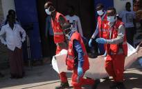 Paramedics carry away the dead body of civilian killed after an explosion outside a restaurant in Mogadishu, on 28 March 2019. Picture: AFP