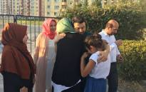 Taner Kilic is embraced by his loved following his release from prison. Picture: @amnesty/Twitter.