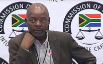 A YouTube screengrab of Ronald Shingange, the former advisor to the late former Minister in the Presidency Collins Chabane, appearing at the state capture inquiry on 14 January 2020.