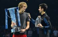 Alexander Zverev chats to Novak Djokovic as they pose with their trophies after the men's singles final match on day eight of the ATP World Tour Finals tennis tournament at the O2 Arena in London on 18 November 2018. Picture: AFP