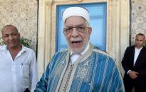 First Vice President of the Assembly Abdelfattah Mourou (C) arrives to attend the swearing-in ceremony of Tunisia's parliamentary speaker Mohamed Ennaceur as interim president on 25 July 2019. Picture: AFP