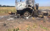 Zenzele residents s set a truck from a nearby mine alight and damaged ten more vehicles on the R28 in a protest over the lack of electricity in the area. Picture: Masa Kekana/EWN