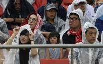 FILE: Rugby fans wear raincoats as they sit in the tribunes prior to the Japan 2019 Rugby World Cup Pool D match between Georgia and Fiji at the Hanazono Rugby Stadium in Higashiosaka on 3 October 2019. Picture: AFP.