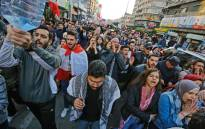Lebanese anti-government protesters shout slogans during a demonstration in the northern port city of Tripoli, on January 14, 2020. Picture: AFP.