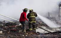 FILE: Firefighters put out smouldering embers amid the debris left by a huge blast that occurred in a fireworks market in Mexico City in 2016. Picture: AFP.