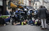 "Protesters taking part in an event called ""BenallApero"", on 1 May, 2019, prevent police from accessing the Contrescarpe square in Paris, a site where a former Elysee senior security officer had been caught on video hitting a protester during a May Day rally. Picture: AFP"