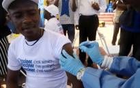 FILE: A World Health Organisation worker administers a vaccination during the launch of a campaign aimed at beating an outbreak of Ebola in the port city of Mbandaka, Democratic Republic of Congo, on 21 May 2018. Picture: Reuters