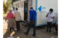Voting station presiding officer supervising voters as they arrive at a voting station to vote in the by-elections in Ward 30, at Rantailane Secondary School in Ga-Rankuwa on 19 May, 2021. Picture: Boikhutso Ntsoko/EWN.