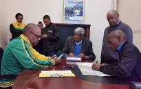 ANC national spokesperson Pule Mabe, together with the party's legal advisor Krish Naidoo, lays a criminal complaint against Steve Hofmeyr with the South African Police Service, on 24 June 2019. Picture: @MYANC/Twitter