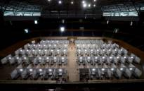 Workers prepare a make-shift field hospital inside the Tien Son sports complex amid the spread of the COVID-19 coronavirus in Danang on 5 August 2020. Picture: AFP