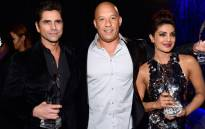 Actors John Stamos, Vin Diesel, winner of the award for Favorite Movie, and Priyanka Chopra attend the People's Choice Awards 2016 at Microsoft Theater on 6 January 2016 in Los Angeles. Picture: AFP