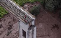 Aerial view of a fallen bridge taken after the collapse of a dam which belonged to Brazil's giant mining company Vale, near the town of Brumadinho in southeastern Brazil, on 25 January 2019.  Picture: AFP