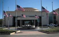 Flags fly at half-mast in front of the George H.W. Bush Presidential Library Center on the campus of Texas A&M University on 2 December, 2018 in College Station, Texas. Bush, who died on 30 November, will be buried next to his wife Barbara near the library on Thursday. Picture: AFP.