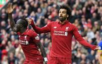 Liverpool's Senegalese striker Sadio Mane (L) and Liverpool's Egyptian midfielder Mohamed Salah gesture during the English Premier League football match between Liverpool and Southampton at Anfield in Liverpool, north west England on 22 September 2018. Picture: AFP