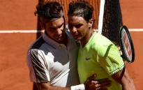 Spain's Rafael Nadal (R) hugs Switzerland's Roger Federer (L) after winning their men's singles semi-final match on day 13 of The Roland Garros 2019 French Open tennis tournament in Paris on 7 June 2019. Picture: AFP