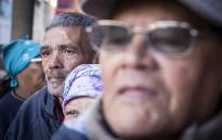FILE: Pensioners queue outside of a supermarket in Mitchells Plain to collect their Sassa grants. Picture: Thomas Holder/EWN.