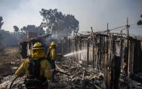 Firefighters battle the Tick Fire in houses on fire in Brentwood, California on 28 October 2019. Picture: AFP