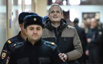 Dennis Christensen, a Danish Jehovah's Witness accused of extremism, is escorted into a courtroom to hear his verdict in the town of Oryol, in Russia on 6 February 2019. Picture: AFP